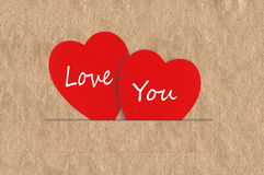 Paper hearts on brown background, close up Royalty Free Stock Photo
