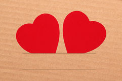Paper hearts on brown background, close up Royalty Free Stock Image