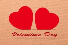 Paper hearts on brown background, close up Royalty Free Stock Photos