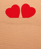 Paper hearts on brown background Stock Photography