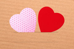 Paper hearts on brown background close up Stock Image