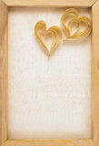 Paper hearts on the canvas frame Stock Images