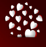 Paper hearts on dark red background Royalty Free Stock Images