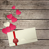 Paper hearts and envelope on wooden Stock Image