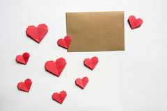Paper hearts and golden greeting card Royalty Free Stock Photo
