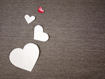 Paper hearts. On grey fabric Stock Photography