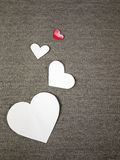 Paper hearts. On grey fabric Stock Photo
