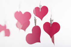 Paper hearts hanging. On white backgroun Stock Images