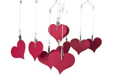 Paper hearts hanging. On white backgroun Royalty Free Stock Image