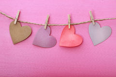 Paper hearts hanging from string with clothespins Stock Images