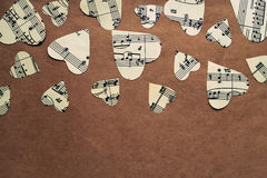 Paper hearts with music notes on craft paper. Background Stock Images