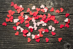 Paper hearts on old background Stock Photo