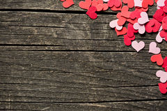 Paper hearts on old background Stock Photos