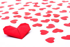 Paper Hearts on paper. Folding heart paper with some red heart paper on white paper Royalty Free Stock Photography