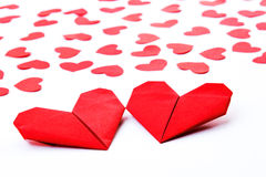 Paper Hearts on paper. Folding heart paper with some red heart paper on white paper Royalty Free Stock Image