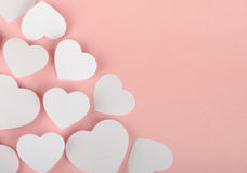 Paper hearts on pink background Stock Image