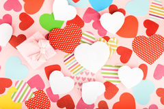 Paper hearts on pink background Royalty Free Stock Photo