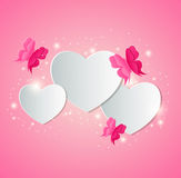 Paper hearts and red butterflies Stock Images