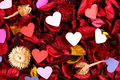 Paper hearts on red potpourri Stock Photos