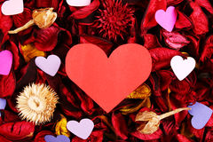 Paper hearts on red potpourri - Series 2 Stock Image
