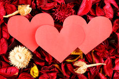 Paper hearts on red potpourri - Series 5 Stock Photo