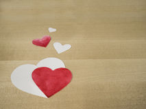 Paper hearts. Red and white paper hearts on wood Stock Photography