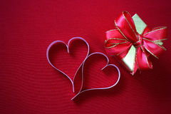 Paper hearts shape wiht gift box on red background Royalty Free Stock Photo