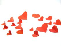 Paper hearts on white background. Red paper hearts on a white background stock image
