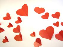 Paper hearts on white background. Red paper hearts on a white background royalty free stock photos