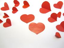 Paper hearts on white background. Red paper hearts on a white background royalty free stock images