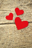 Paper hearts on wood background Stock Photo