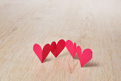 Paper hearts on wood Stock Image