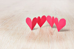 Paper hearts on wood Royalty Free Stock Images
