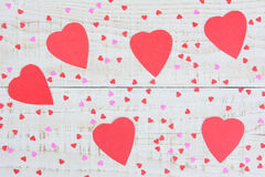 Paper Hearts on a Wood Table Royalty Free Stock Images