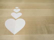 Paper hearts on wood. White paper hearts on wood Royalty Free Stock Photo