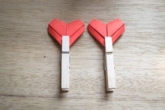 Paper hearts and wooden cloth pegs Royalty Free Stock Photography