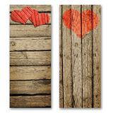 Paper hearts on a wooden surface Royalty Free Stock Image