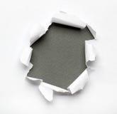 Paper hål för genombrott Arkivbilder