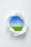 Paper hole with nature background Royalty Free Stock Photos