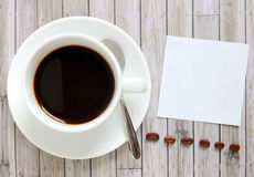 Paper with hot coffee cup and coffee beans Stock Photo