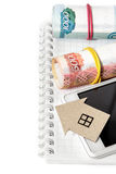 Paper Hous, Russian money, mobile phone and notepad. Vertical edge Royalty Free Stock Image