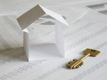Paper house. With key on financial documents. Shallow dof Stock Images