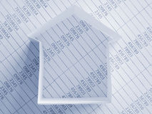 Paper house. On financial figures. Up view. Toned blue. Shallow dof Royalty Free Stock Photos