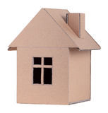Paper house. The concept, the house from the goffered cardboard, isolated on a white background Royalty Free Stock Photography