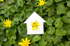 Paper house against green background. Real Estate Concept Royalty Free Stock Photo