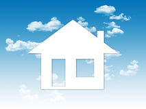 Paper house on a blue sky backgroung Royalty Free Stock Images