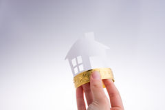 Paper house with a bracelet Stock Images