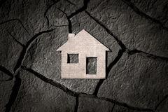 Paper house on cracked earth Stock Photography