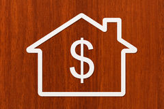 Paper house with dollar sign inside. Abstract conceptual image Royalty Free Stock Photo