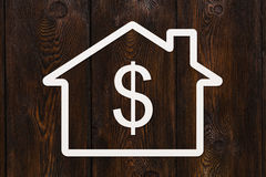 Paper house with dollar sign inside. Abstract conceptual image Stock Images